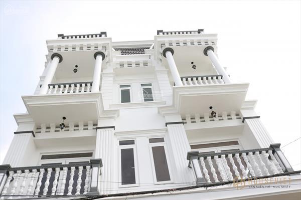 Nhà phố thương mại, mặt tiền chợ mới Bình Minh, trung tâm thị xã, dân cư đông đúc qua lại.